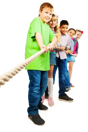 Group of five diversity looking kids, boys and girls pulling the rope together standing in a line as a team, isolated on white with fat boy girl on front Stock Photo - 18394970