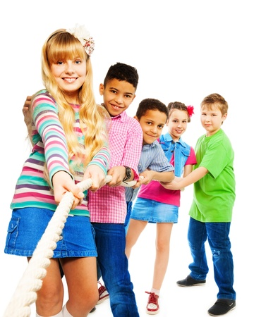 Group of five diversity looking kids, boys and girls pulling the rope together standing in a line as a team, isolated on white with blond girl on front Stock Photo - 18420712