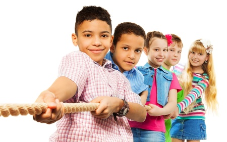 working together: Diversity kids boys and girls buplling the rope isolated on white