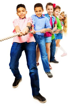 Group of five diversity looking kids, boys and girls pulling the rope together standing in a line as a team, isolated on white with black boy girl on front Stock Photo - 18420882