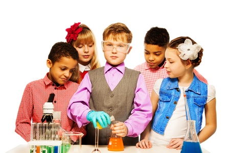 Group of five kids boys and girls with microscope and test tubes and flasks in chemistry class, isolated on white photo