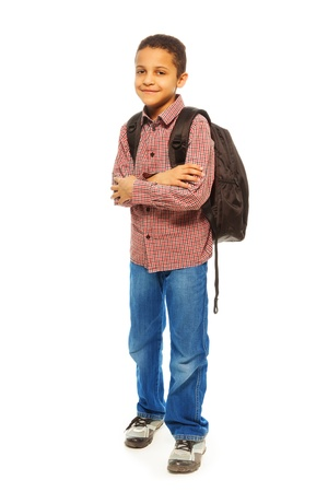 Cute 8 years old black boy with backpack - full height portrait isolated on white photo