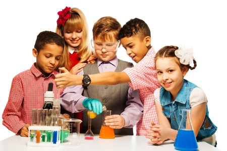 science lesson: Group of five diversity kids boys and girls blond and brunet with microscope and test tubes and flasks in chemistry class, isolated on white