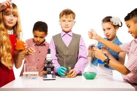 Group of five kids boys and girls blond and brunet with microscope and test tubes and flasks in chemistry class, isolated on white photo
