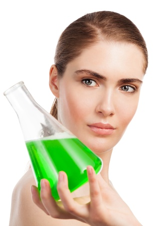 Makeup laboratory beauty scientist portrait - woman holding tube glass with green liquid photo