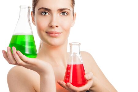 Makeup laboratory beauty scientist portrait - woman holding two flasks glass with red and green chemicals photo