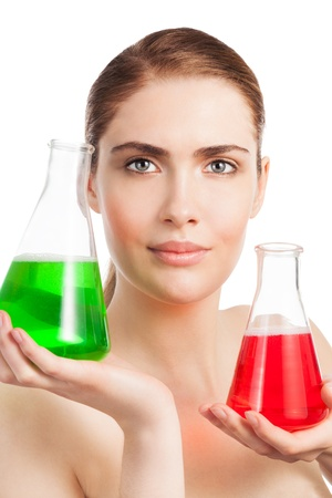Makeup laboratory beauty scientist portrait - woman holding two flasks glass with red and green substances photo