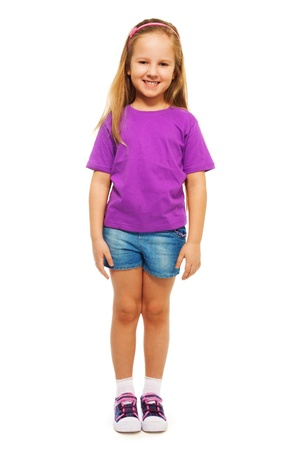 6 years: Happy smiling 6 years old girl  full height portrait isolated on white