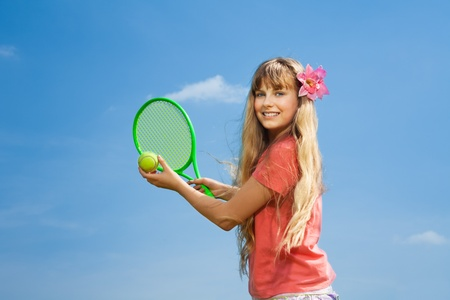 Beautiful blond 10 years old little girl with tennis  racquet photo