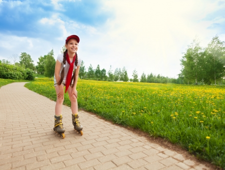 10 years old: Close portrait of brunet happy little 10 years old girl scatting in the park Stock Photo