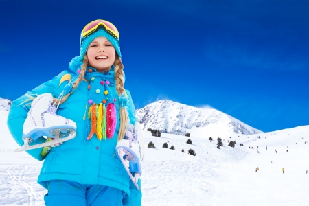 10 years old: Happy 10 years old Caucasian girl with ice-skates outside on winter day