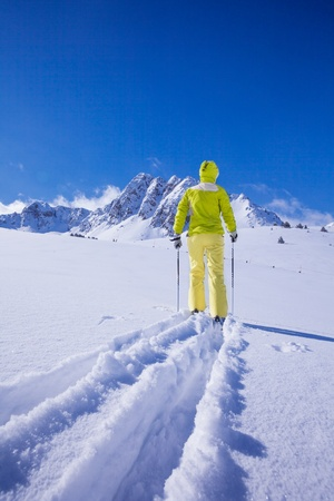 concur: One man walking with ski over the snow land to the mountain