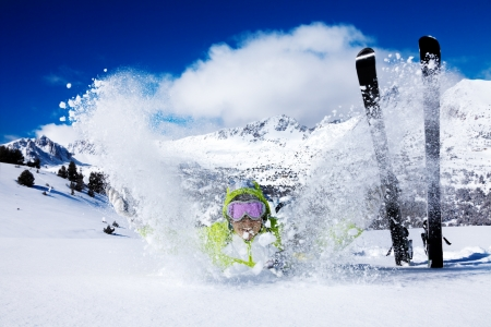 Young happy skiing woman have fun throws snow