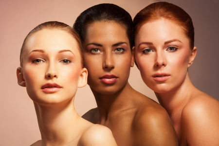 Three women with different appearance in a together beauty portrait face to face photo