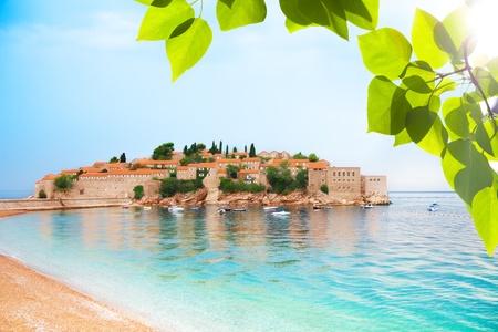 entire: Beautiful entire Sveti Stefan peninsula in Montenegro with sandy beach Stock Photo
