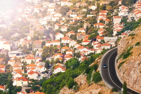 City of Dubrovnik and highway over the mountains towards it photo