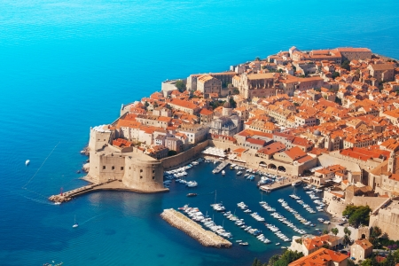 marina water: Old fort of Dubrovnik from the birds view with blue sea and boats