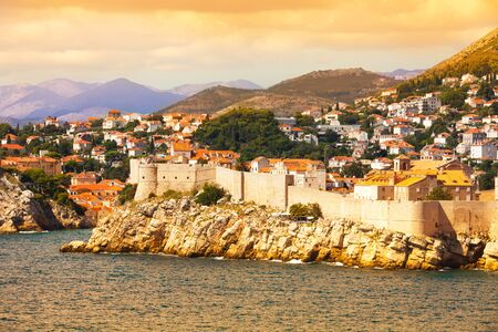 Old town of Dubrovnik, Croatia at sunset from the sea photo