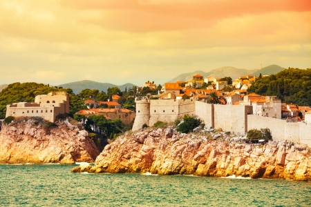 Old town of Dubrovnik, Croatia from the sea at sunset photo