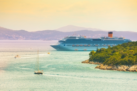 Cruiser liner in the port of Dubrovnik, Croatia with shuttles going to and from city photo