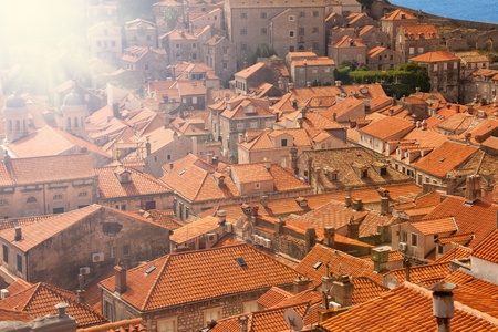 Red tile roofs of old town Dubrovnik on sunny day photo