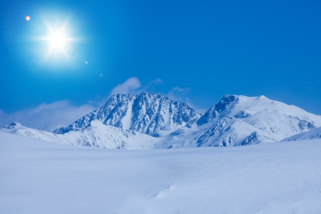 tourism in andorra: Snow plateau landscape and high mountain rocky peaks in Andorra