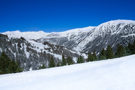 piste: Mountain landscape background in ski resort with part of piste Stock Photo