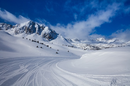 tourism in andorra: Fresh ski slope and mountains in sunny day