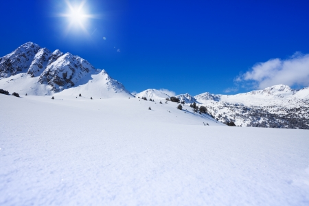 Snow and high mountain peaks landscape in winter on sunny day