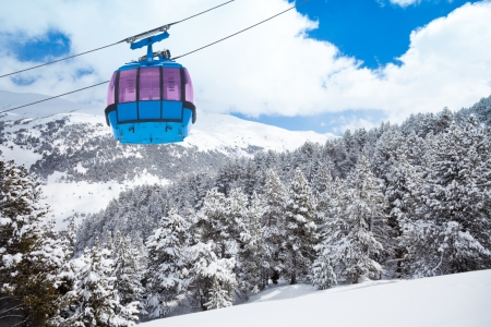 Closeup of ski lift cable car and forest covered with snow on the background photo
