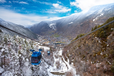 tourism in andorra: Encamp town in Andorra and cable car for lifting skiers and snowboarders to the top of the mountain