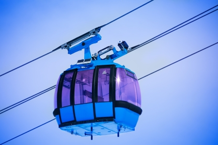 Close-up of cable car over the blue sky photo