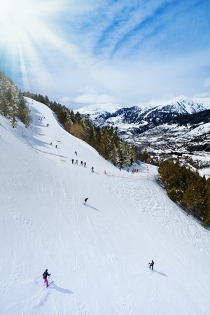 tourism in andorra: Ski resort in Andorra with skiers sliding down the slope