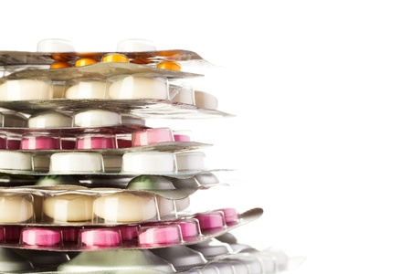 packs of pills: Close-up of aluminum packages with tablets, pills and other drugs isolated on white