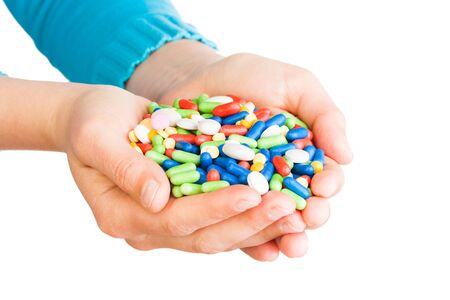 handful: Two hands full of large pile of different pills