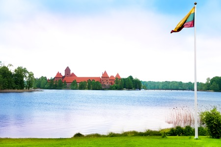 Symbol of Lithuania Trakai castle and country flag with the lake
