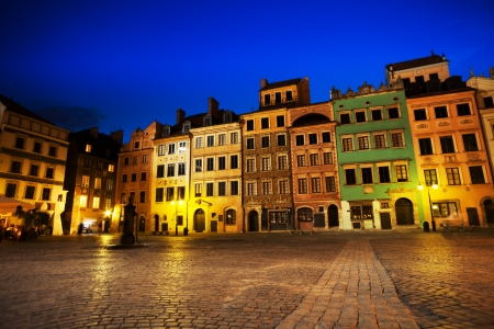 polska monument: Warsaw old town marketplace square at night with colorful houses and stone pavement in Poland