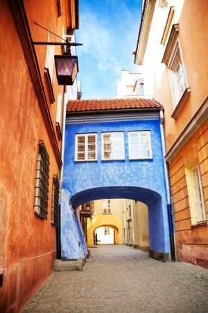cobblestone street: Little parasite home bridge on narrow Dawna street in Warsaw, Poland