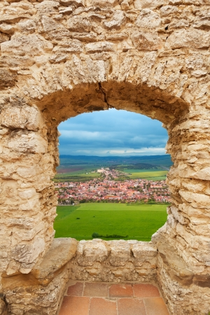 loophole: Loophole of the castle and view of Spis hrad on the north of Slovakia