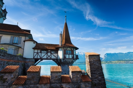 historical building: Oberhofen Switzerland view on the tower in the water from forts walls