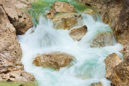 neuschwanstein: Closeup of the stones and moving water of part of waterfall under Neuschwanstein castle