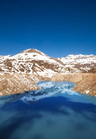 Lake Emosson reservoir of hydroelectric Dam near village of Chatelard, Swiss on the border with France photo