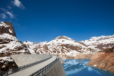 The Emosson hydroelectric Dam near village of Chatelard, Swiss on the border with France at spring photo