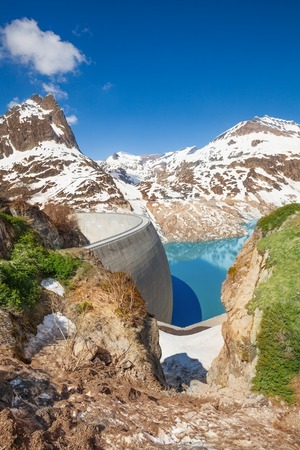 ice dam: Spring at Emosson lake and huge concrete hydroelectric Dam near village of Chatelard, Swiss on the border with France