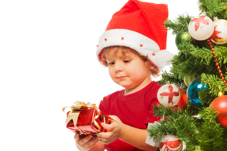 three presents: Happy 3 years old boy with little red present box Stock Photo