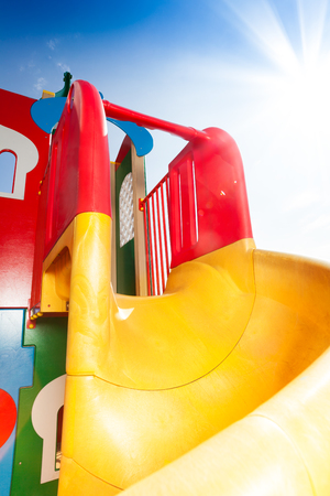 Beautiful slide at playground colorful with sky on background photo