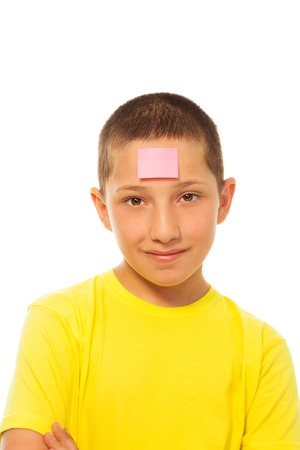 forehead: Portrait of happy young boy with sticker on his forehead Stock Photo
