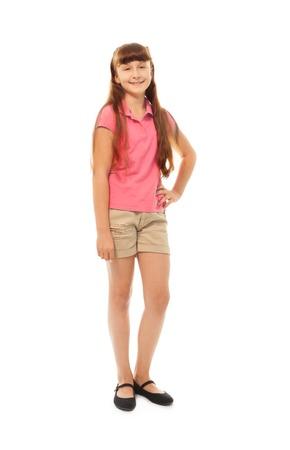 full height: Full height portrait of a girl standing isolated on white in full height