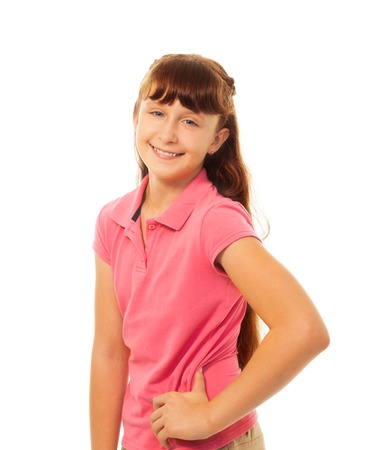 whie: Portrait of happy smiling little school age girl standing isolated on whie