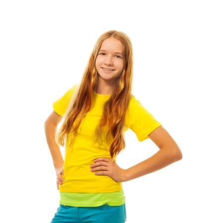 full height: Portrait of happy smiling little girl in  standing isolated on white, full height portrait Stock Photo